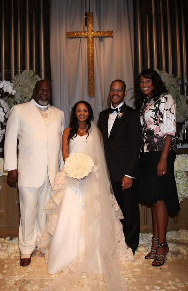 Bishop T.D. Jakes (Left) Poses with Yolanda Adams (Right) and bride