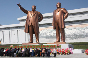 north-koreans-bow-before-the-statues-of-kim-il-sung-left-and-kim-jong-il-on-mansu-hill-in-the-capital-of-pyongyang-in-this-2012-photo