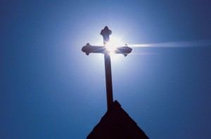cross-silhouetted-on-church-roof