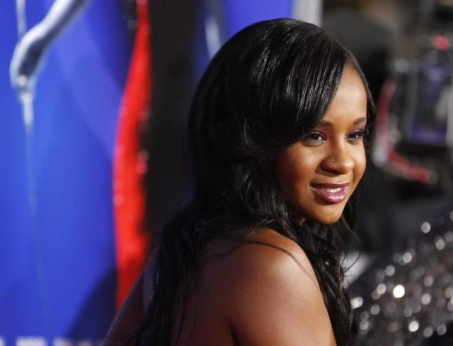 Brown daughter of the late singer Houston poses at premiere of Sparkle in Hollywood